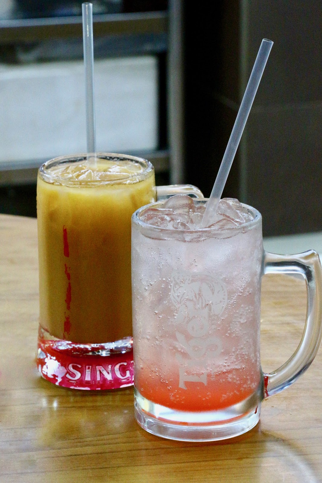 Siam Square Mookata thai iced milk tea and strawberry soda